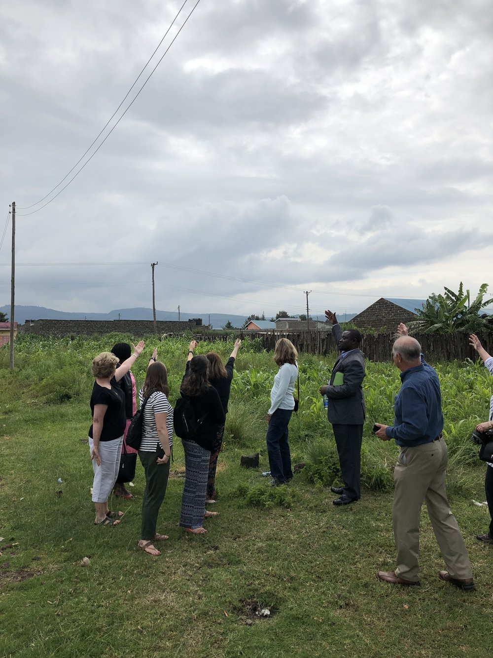 The team points to the future borehole site.