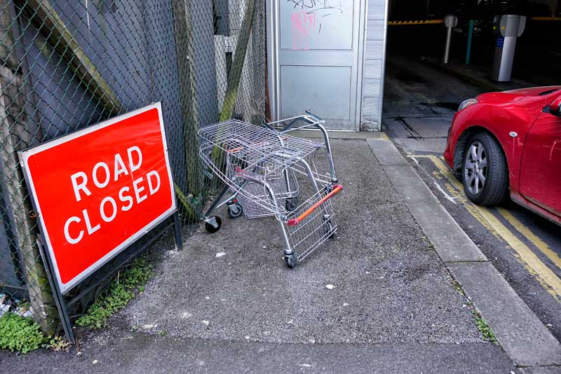 red trolley abandoned road closed car park