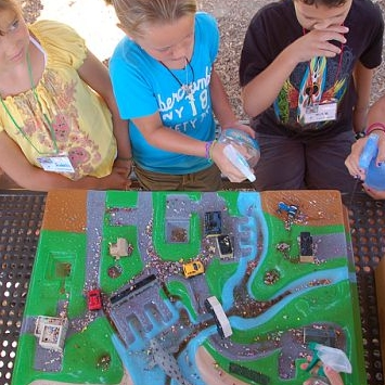 Children learning about watershed runoff