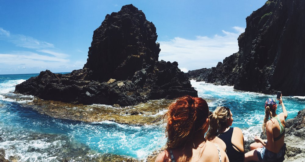Selfies from the cove on the back of Moku Nui after our kayak trip. Featuring weird panorama photo hair.