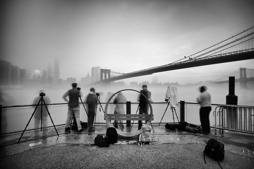 Long exposure photographers capturing a foggy sunrise in brooklyn bridge park rod clark