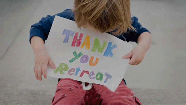 Little-Boy-with-Retreat-Sign.jpg
