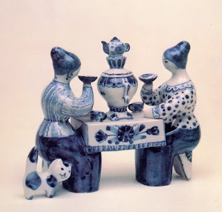 women drinking tea figurines.jpg