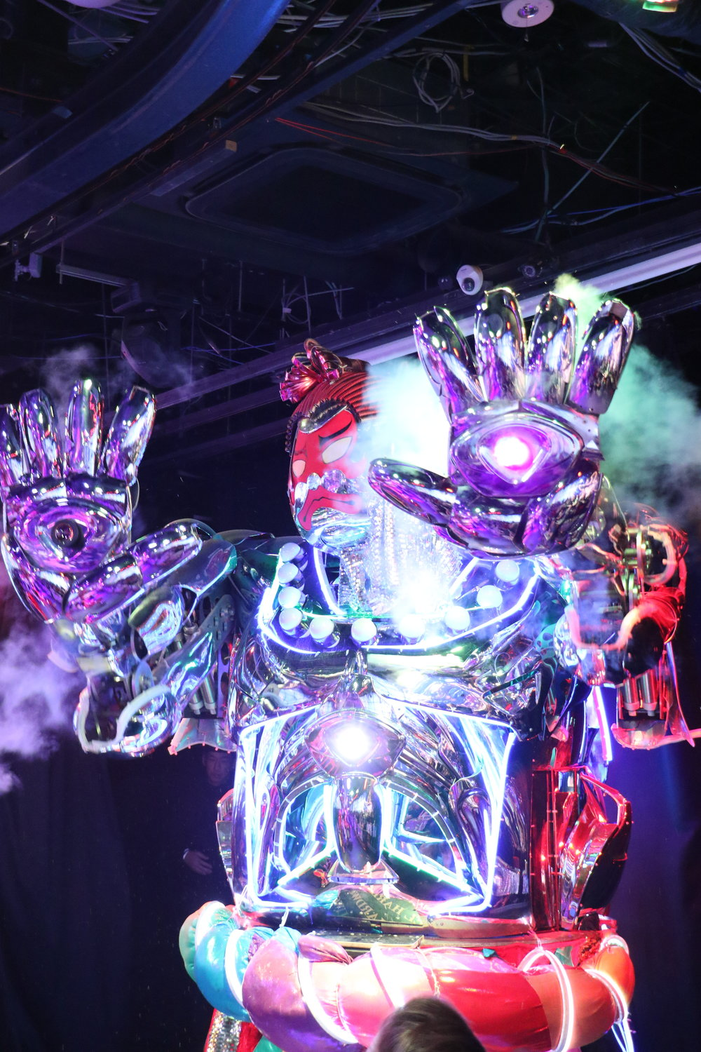 Neon robot preforms disco dance as part of entertainment at Robot Restaurant in Shinjuku's entertainment district.
