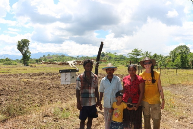Myself, my field assistant Supun Herath, and the Somathilaka family, standing beside the first beehive fence to be built in Sri Lanka