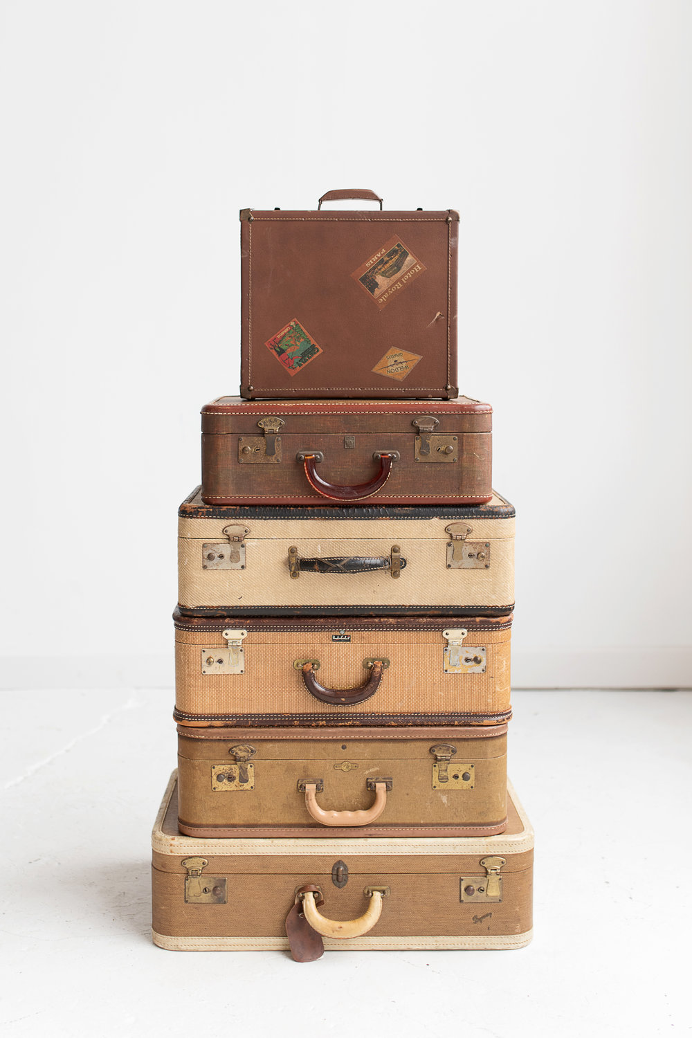 Stack of Brown Suitcases