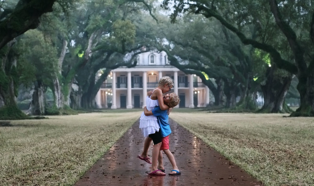 One of my favorite pictures ever- these two, hugging in through the downpour