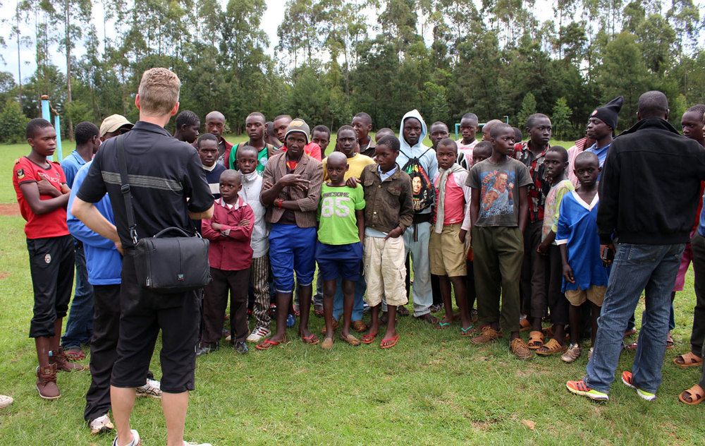 A local soccer team - Marko recently arranged for these boys to all receive new soccer cleats & gear!
