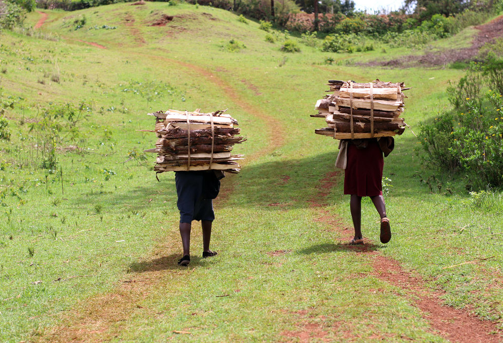 These Ladies Walk through the valley and into the forest each day (sometimes 3 times per day) to gather firewood and carry it home.  We each took turns trying to carry the firewood bundles on our own backs - it literally is back breaking work.