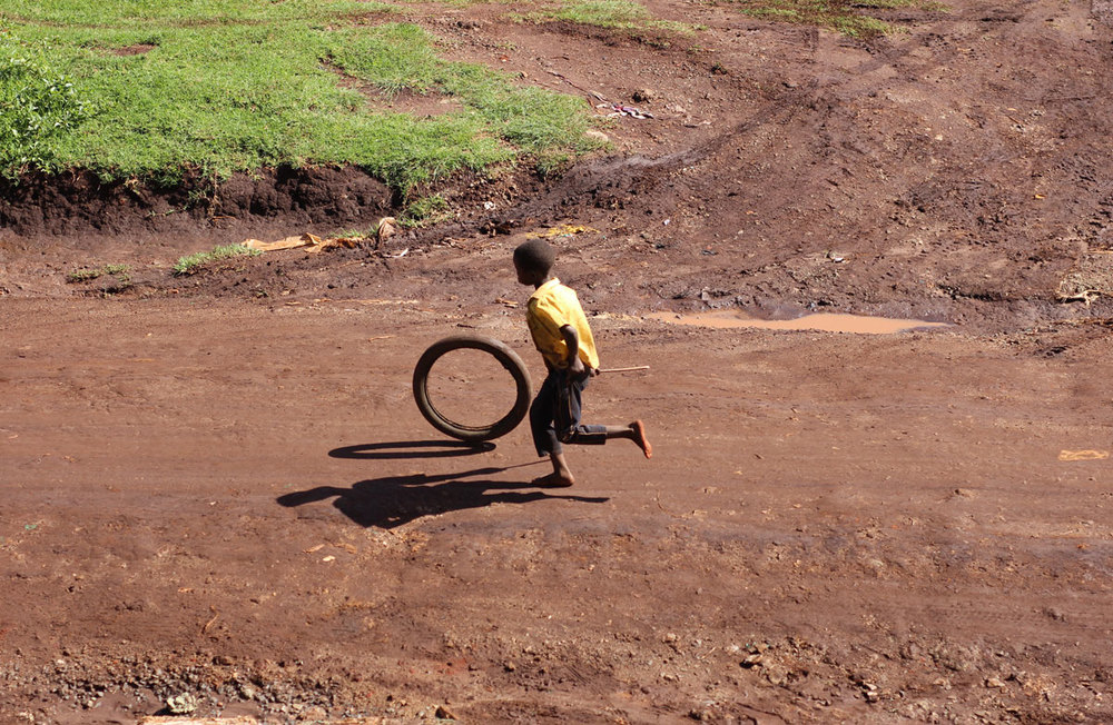 There is something about a tire and a stick... every kid has one.