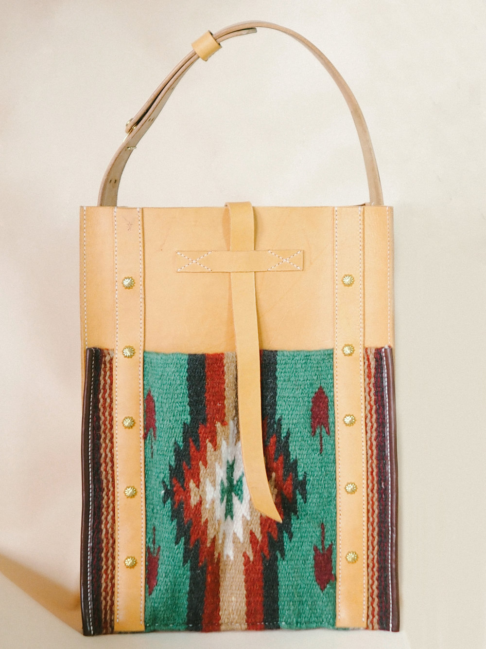 Handmade leather tote with Navajo textile.