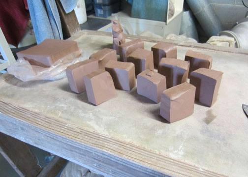Clay slabs waiting to be wheel thrown into a stoneware creation