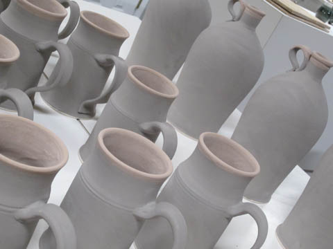 Fully glazed steins waiting for another firing