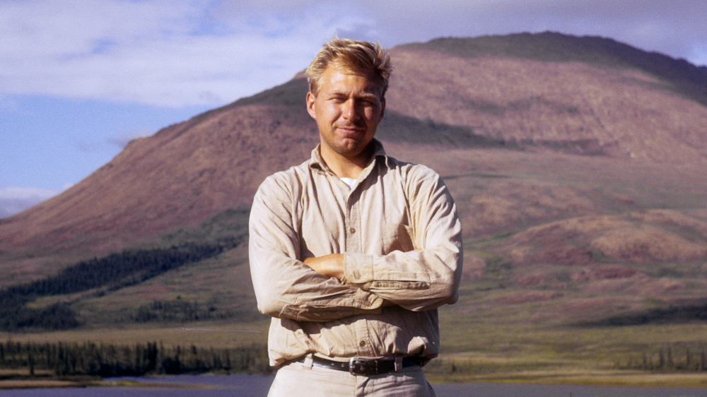 Douglas Anderson on archaeological survey, Kelly River, 1967