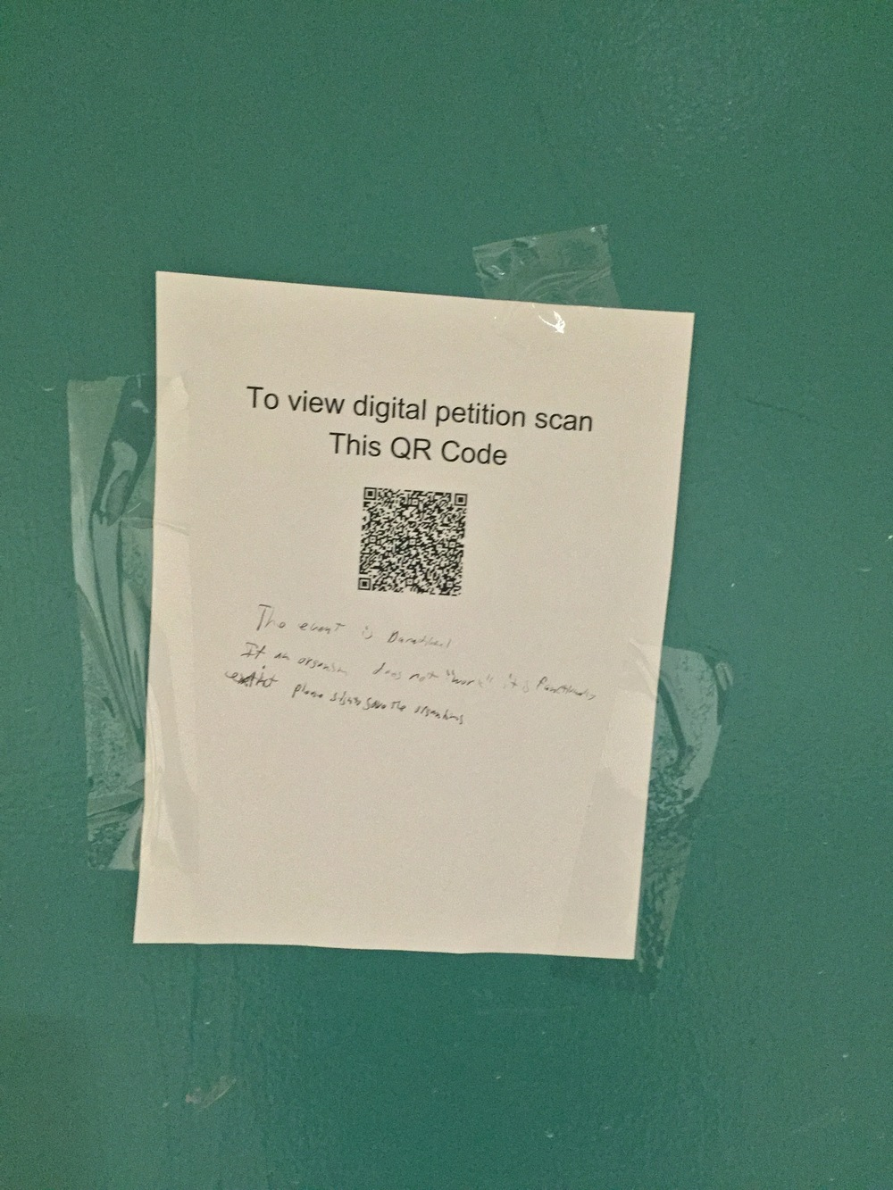 "Detail of QR code to petition and ""note"""