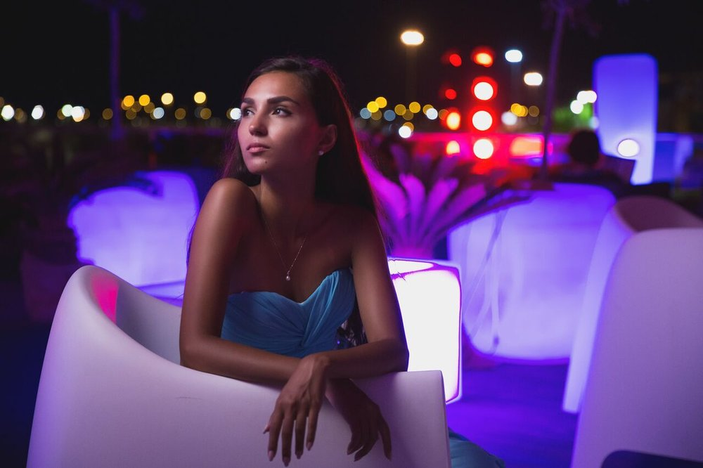 Dramatic photo of bride posting at night with neon lights.jpg