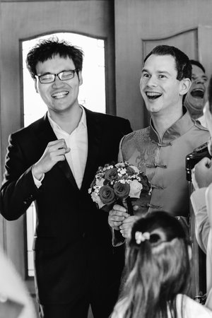 Candid photo of groom and wedding guest.jpg