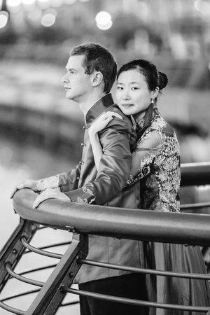 Cride and groom posing near waterfront.jpg