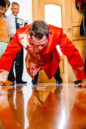 Groom taking part in a traditional chinese wedding game.jpg