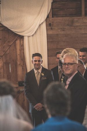 Groom standing at the alter waiting for his bride to come down the aisle.jpg