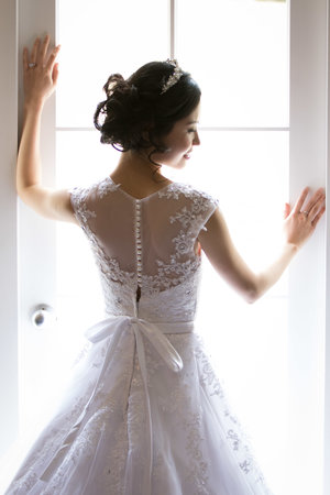 Half shot from the back of bride in her wedding dress.jpg