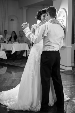 Full length photo of bride and groom having their first dance.jpg