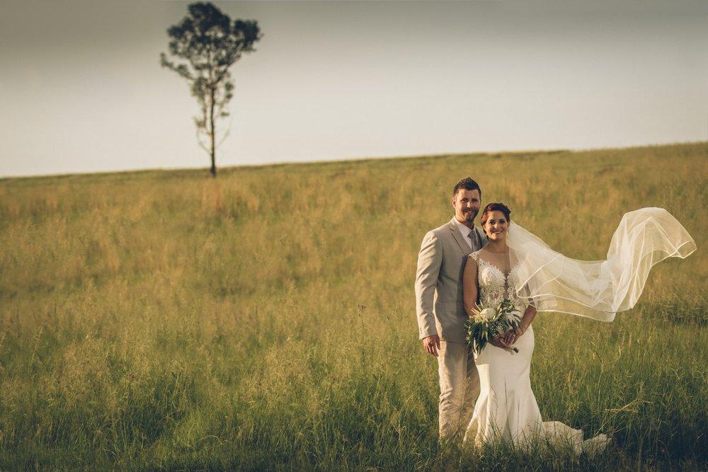 Bride and groom in field.jpg