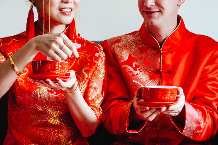 Bride and groom taking part in a traditional chinese wedding tea ceremony.jpg