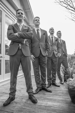 Low angle photo of groom with his groomsmen.jpg