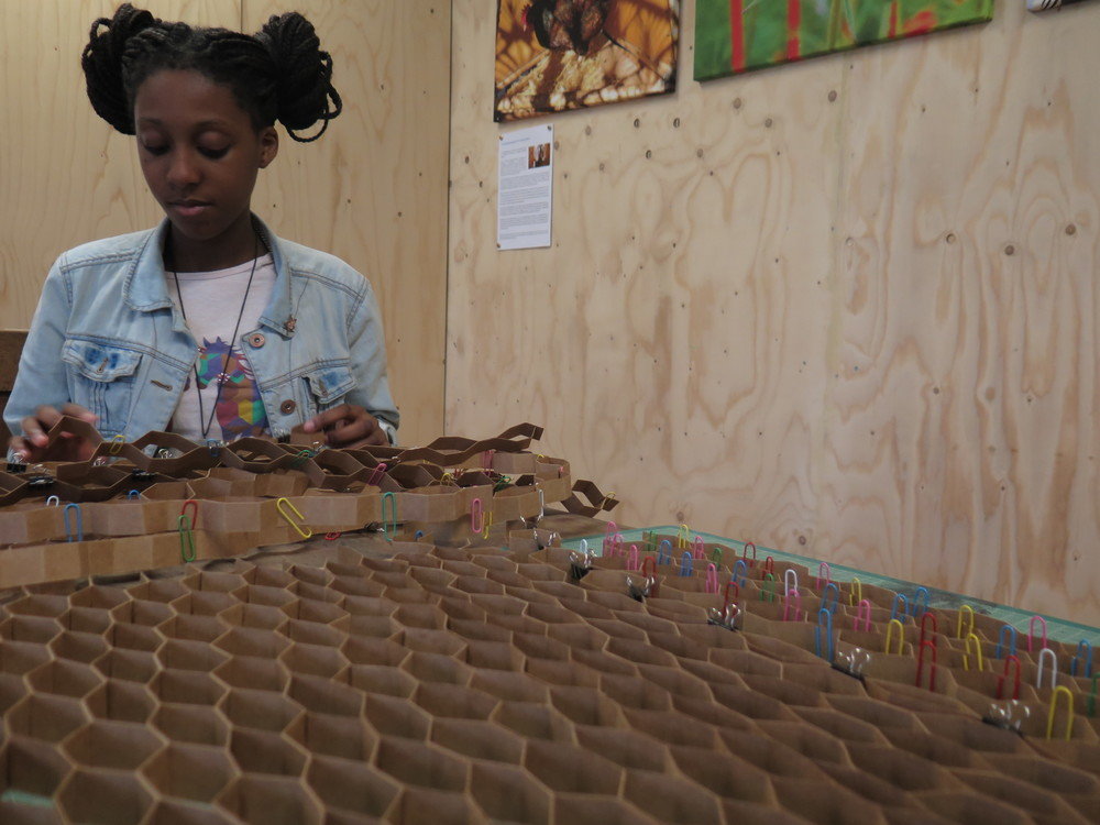 Addie, one of our young women Generators working on the honey comb display