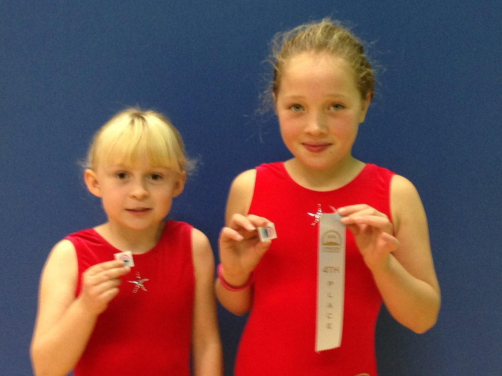 Polly and Kaylin with pins and ribbon.JPG
