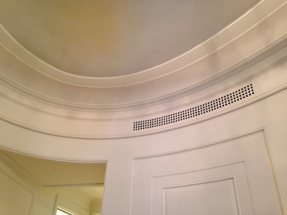 Profile mouldings with an inlaid HVAC grille