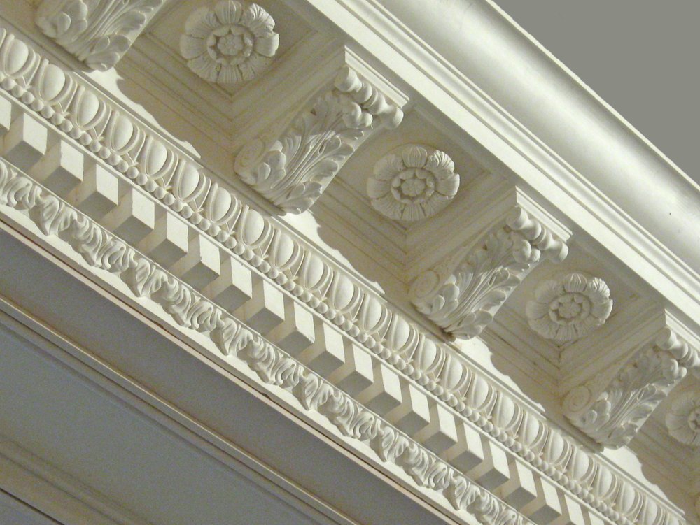 Rosettes, brackets, egg and darts, and more designs come together to form a beautiful crown moulding.