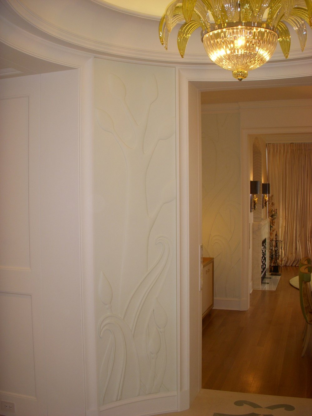 An ornamental bas relief wall finish, these panels cover the walls of many of the rooms in the home