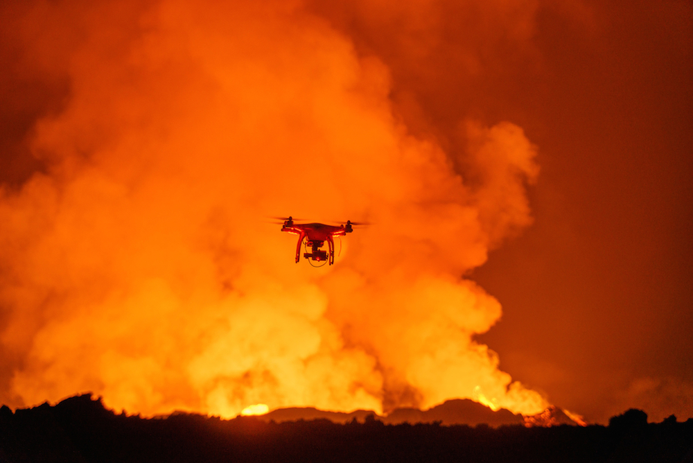 A DJI Phantom 2 quadcopter flying in the Holuhraun lava field, Iceland - Eric Cheng