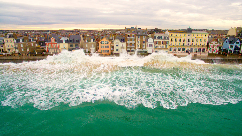 Waves crash against the shore at high tide in northern France - Taken by Easy Ride