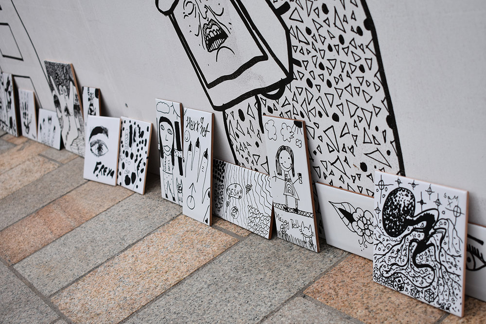 Some of the ceramic tiles created as part of the overall piece of work