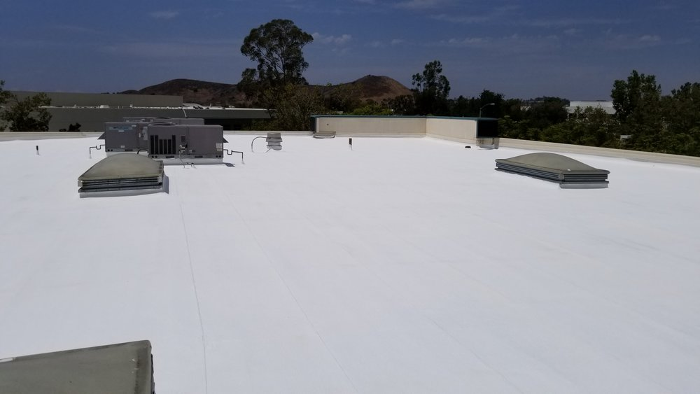Roof coating at warehouse in South Orange County