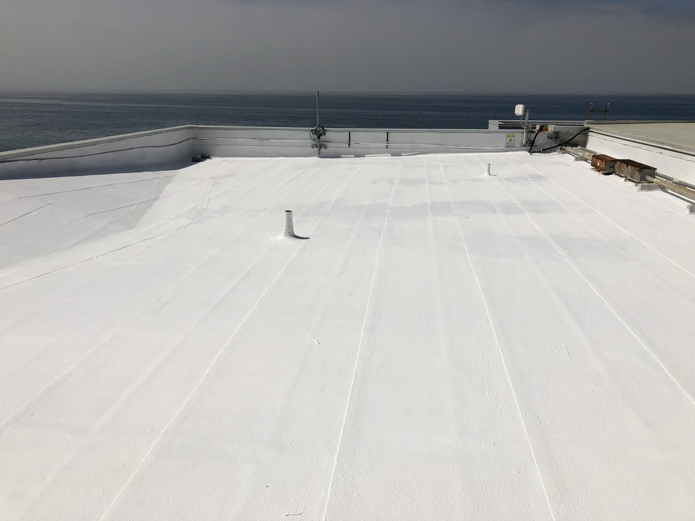 Roof coating on surf shop in Malibu, California