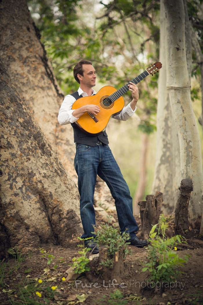 Paul Renslow playing classical guitar in nature.