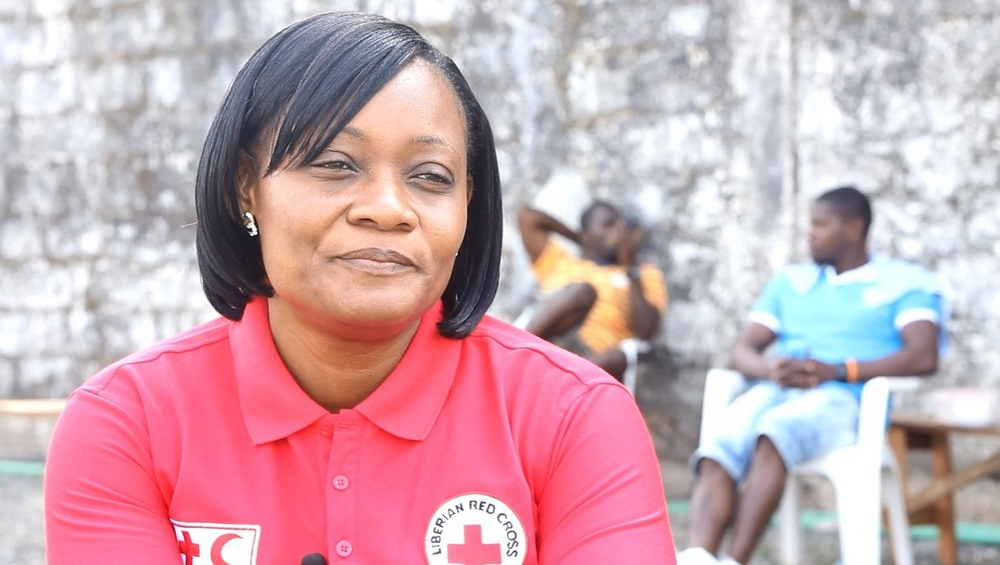 Roselyn Nuguba-Ballah is the coordinator of the Liberian Red Cross's safe and dignified burial team, which have buried 3,535 Ebola victims in in a safe and dignified way since the outbreak began. (Nurudeen Sanni/IFRC)