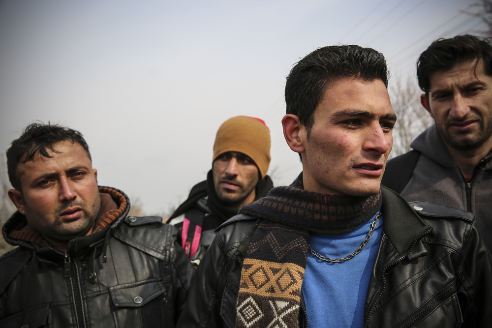Zayed, 16, second from right, was among a group of Afghan men walking through the Turkish village of Uzgac who reported being pushed back from the border by Bulgarian police.