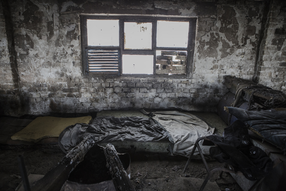 Mattresses and an abandoned fire mark the spot where migrants have been sleeping on the first floor of the old brick factory in Subotica.