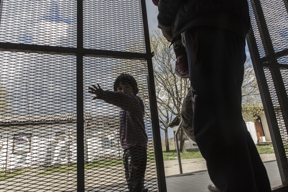 A Syrian child at the entrance to the Krynjaca asylum centre.