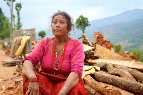 Rita Rai sits on the debris of her home in the remote village of Banghar