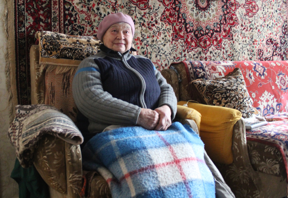 Anna Reshedko, 78, wraps herself in blankets and covers the walls with carpets to stave off the freezing cold