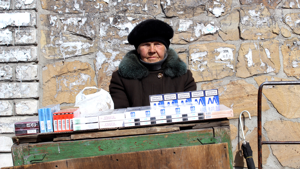 Anna Vasiliyevna, 83, makes 25 cents a day selling cigarettes