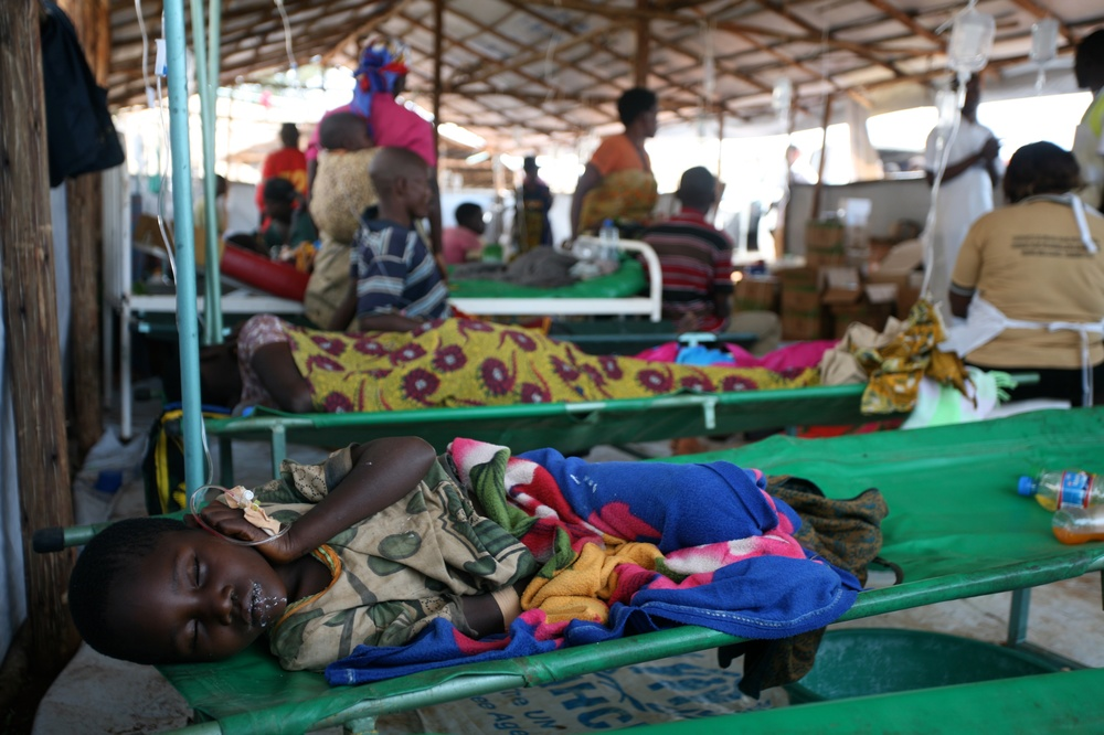 A child recovers from the journey and sleeps in the health clinic at Lake Tanganyika Stadium in Kigoma, Tanzania