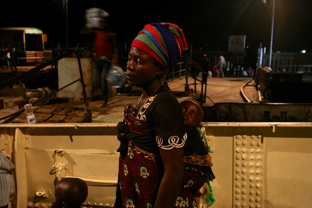 Delphin Nyiyanwi waits aboard the MV Liemba for the body of her 4-year old son to be carried off the boat after he died of suspected cholera.