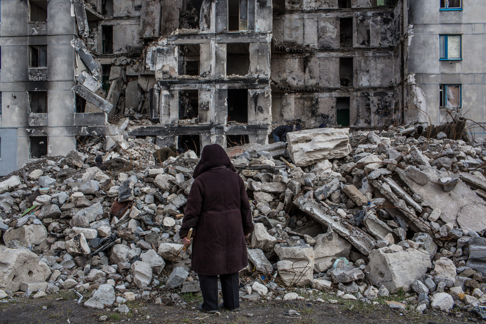 A survey of destruction in Lisichansk, Ukraine. This building was damaged by shelling in July 2014. (Brendan Hoffman for Mercy Corps)